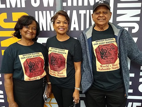 """Members of the Guyana Philatelic society in t-shirts with the image of the world's most expensive brand — """"British Guiana"""". Center: Ann wood, President of the society / Hobby Keeper Articles"""